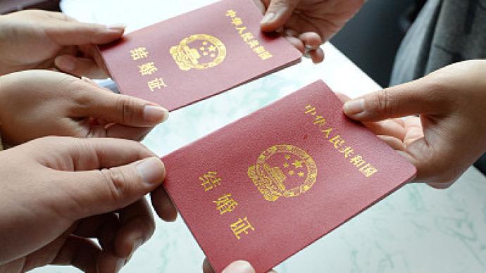 全国政协委员鲁晓明:建议男女结婚法定年龄降低至18岁