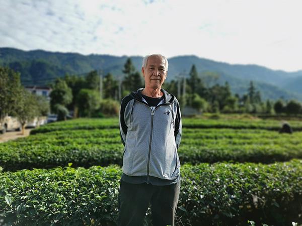 """台湾茶商邓国光说,清流县""""生态很好,政策也很好""""。"""