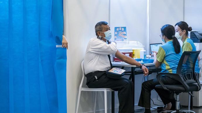 一周图片|香港疫情反复,已有13.5万人预约接种新冠疫苗