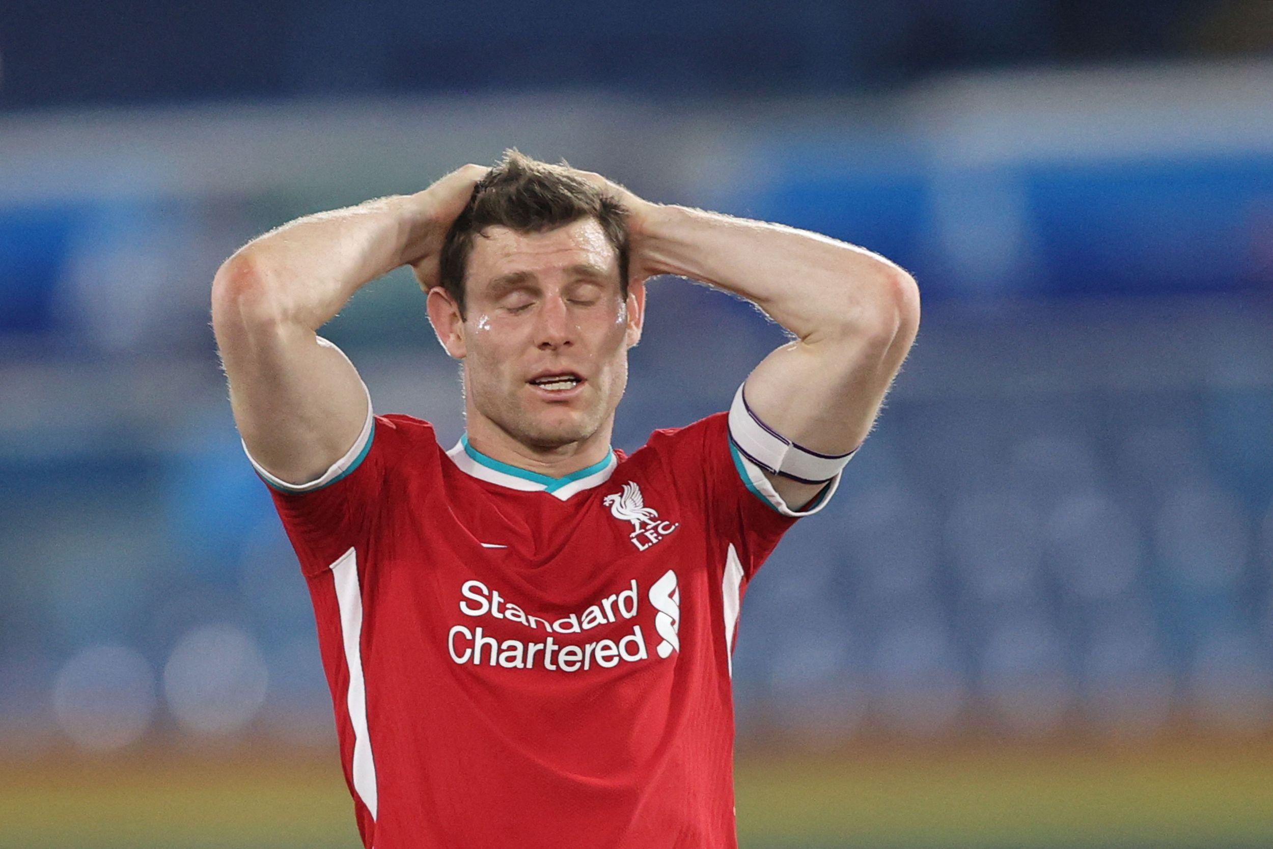 失落的利物浦球员米尔纳。