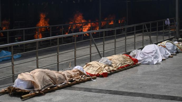 早安·世界|印度連續7天新增病例超30萬,累計死亡超20萬