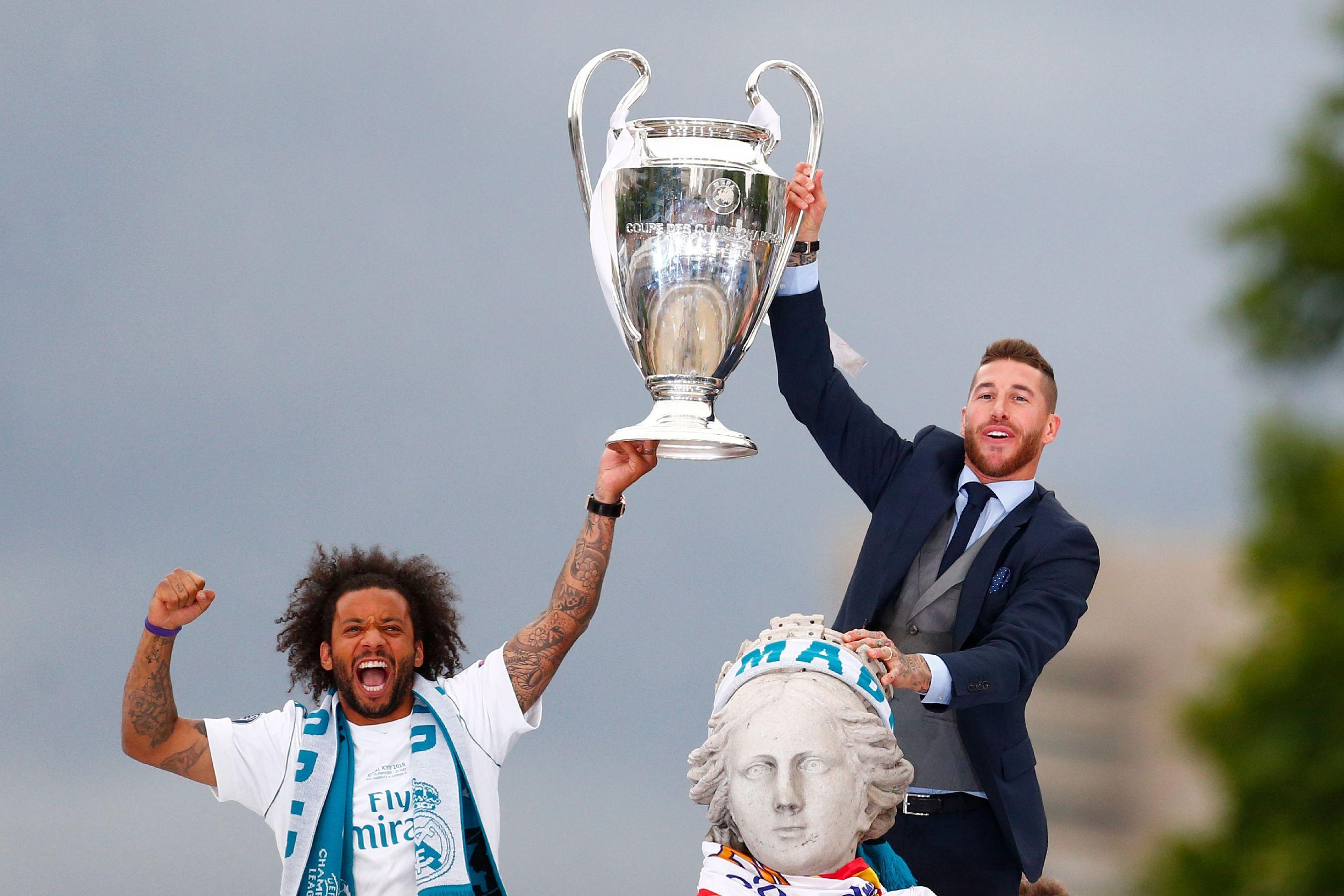 拉莫斯和皇马一起拿下了四座欧冠。