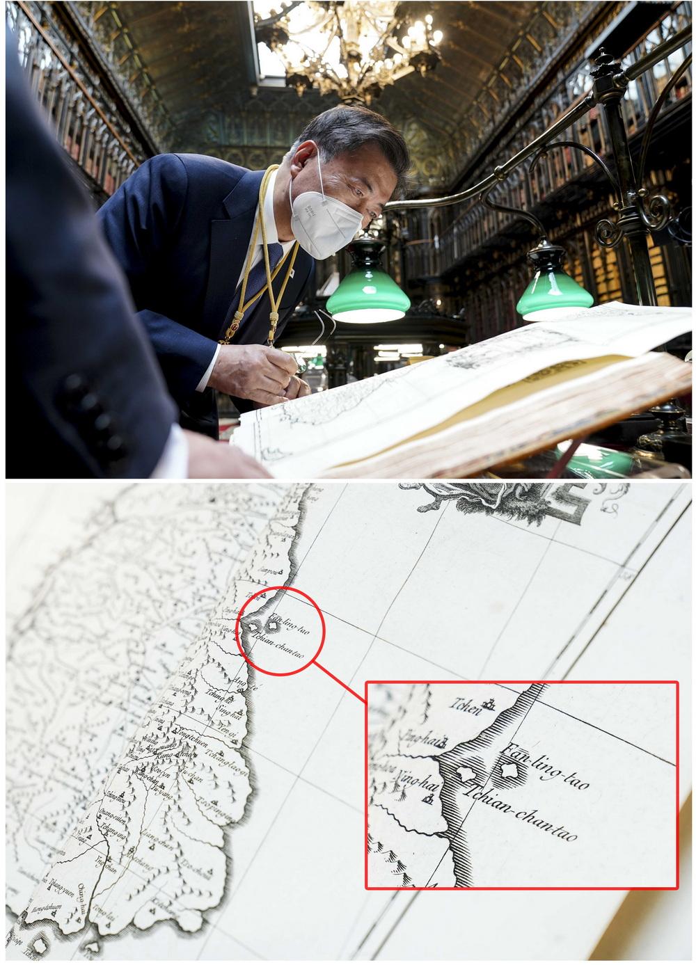 """当地时间2021年6月16日,在西班牙马德里的参议院,文在寅在发表参众两院联合演讲后,参观参议院图书馆,观看《朝鲜王朝全图》。据报道,韩青瓦台发言人朴炅美当天介绍说,文在寅总统观看古地图《朝鲜王国全图》时,发现能证明独岛(日称""""竹岛"""")是韩国领土的珍贵史料。"""