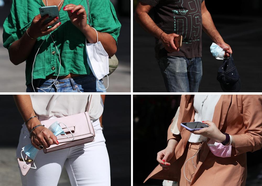 """这张拼版照片显示,当地时间2021年6月17日,人们拿着口罩走在法国巴黎香榭丽舍大街上。法国总理卡斯泰16日宣布,鉴于法国新冠疫情防控好于预期,政府将加快""""解封"""",从17日起,户外一般情况下不再强制戴口罩,提前10天解除宵禁措施,原定本月30日解除宵禁的日期被提前到20日。根据法国卫生部门15日公布的数据,过去24小时法国新增新冠确诊病例3235例,累计确诊5744589例;新增死亡病例76例,累计死亡110563例。"""