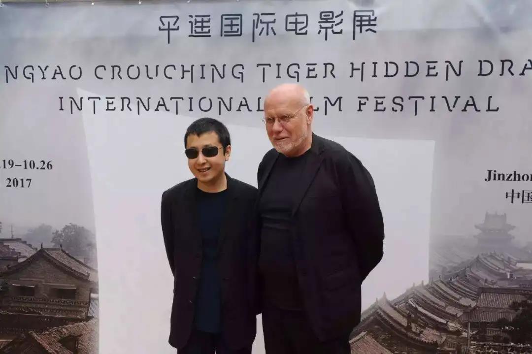 贾樟柯与马可·穆勒(右)在平遥电影节