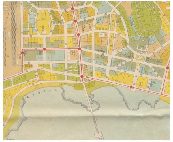 《最新青岛市街一览图》局部,红色为城市公交线路。