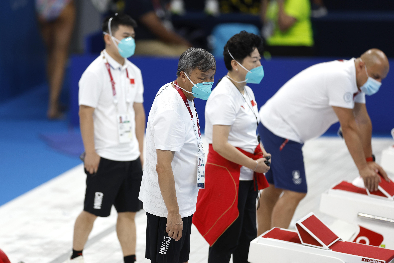 奥运赛场边的朱志根教练。