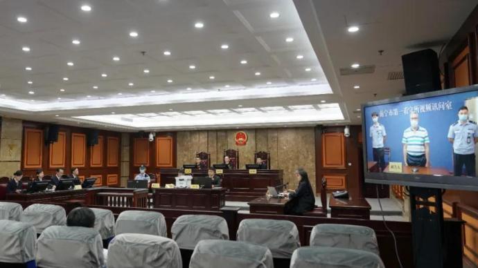 被指控受贿1293万余元!广西中医药大学原副校长覃裕旺受审