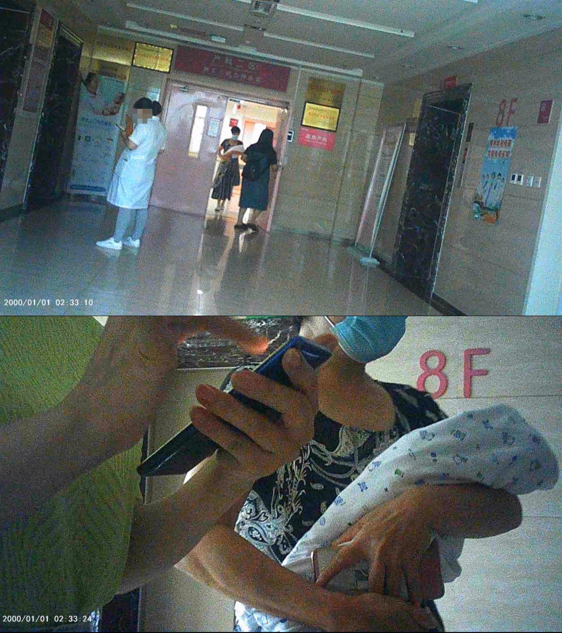 7月29日上午,在潍坊市妇幼保健院8楼,月嫂将男婴抱出拍照。