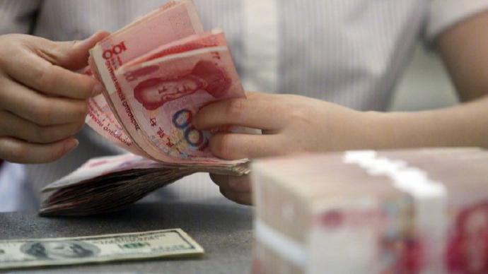 美联储按兵不动,人民币对美元即期汇率反弹升破6.49