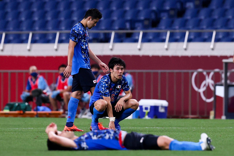 日本球员遗憾不已。