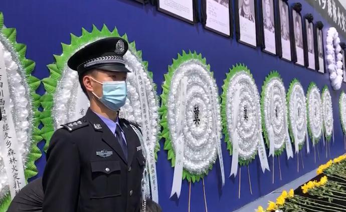 西昌19名勇士集体追悼会,站岗民警泪目