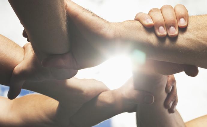 人民日報海外版:唯有團結,人類方能戰勝病毒