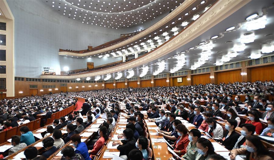 5月21日,中国人民政治协商会议第十三届全国委员会第三次会议在北京人民大会堂开幕。这是委员们在认真听会。