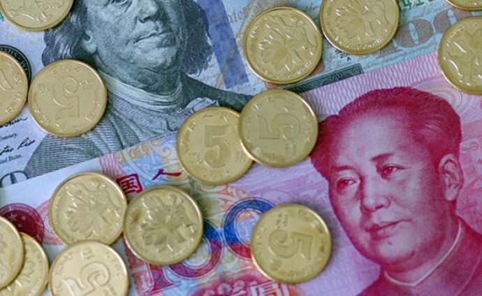 在岸、离岸人民币对美元汇率双双升破7.03