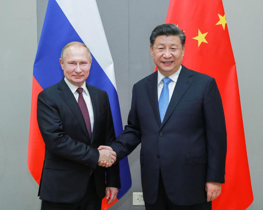 当地时间2019年11月13日,国家主席习近平在巴西利亚会见俄罗斯总统普京。 新华社记者 庞兴雷 摄