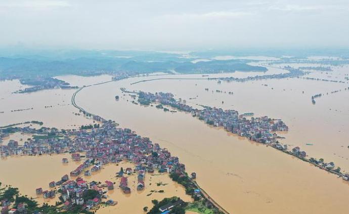 馬上評丨到抗洪救災一線去,筑起保護人民安全的堅固大堤