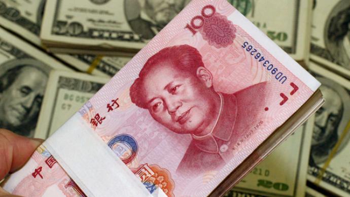 在岸、離岸人民幣對美元匯率雙雙升破6.97