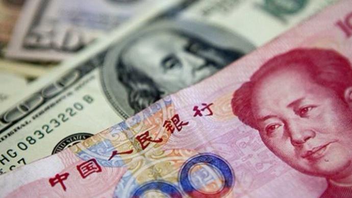 """短線跳水,在岸、離岸人民幣對美元匯率一度跌破""""7""""關口"""