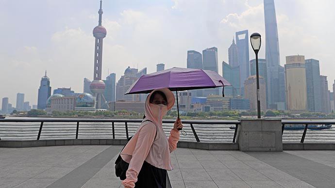 上海高溫預警升級為橙色,預計今天最高氣溫達37℃