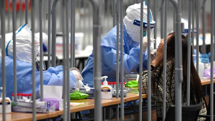 进博直击|探访国展中心核酸采样现场:有条不紊,次日出结果
